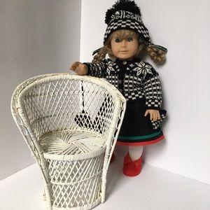 White doll chair.
